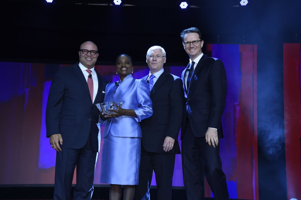 NCTA's Michael Powell, FCC Commissioner Clyburn, and the Kaitz dinner co-chairs.