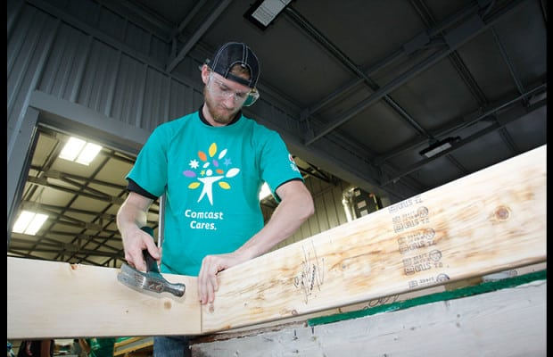 NASCAR Xfinity Series driver Harrison Rhodes participates in a Habitat for Humanity house build in Johnson City, Tenn.