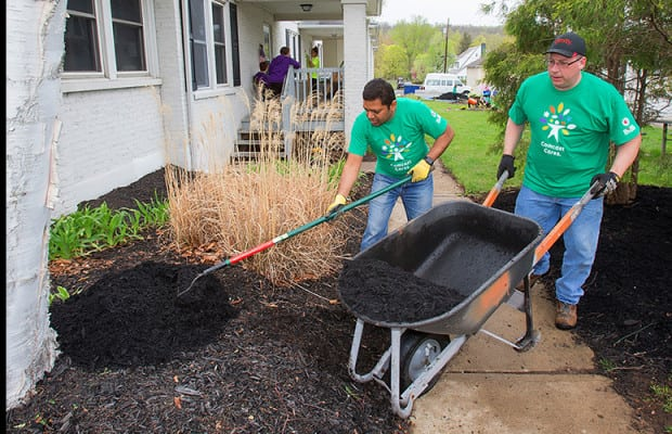 Volunteers in Asbury, N.J. spread mulch at The Arc of Warren County's community living group home, which supports individuals with disabilities.