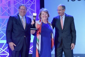 Woman of the Year D'Arcy Rudnay with Comcast CEO Brian Roberts and senior EVP David Cohen. (Photo by Larry Busacca, Getty Images)