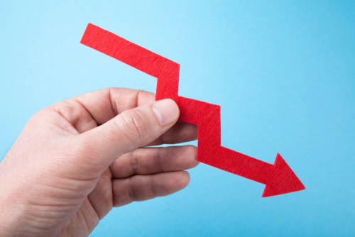downward trend arrow stock image