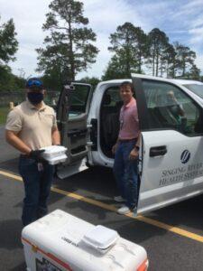 Sparklight employee delivering meals to hospital